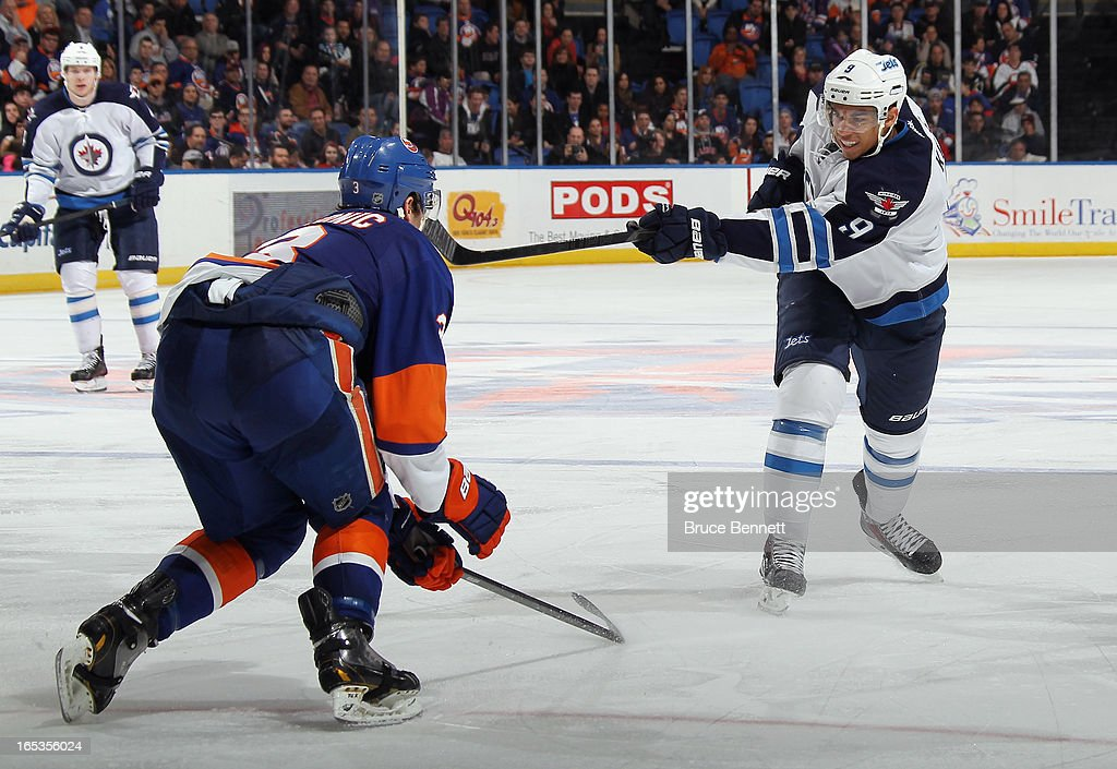 Evander Kane #9 of the Winnipeg Jets skates against the New York Islanders at the Nassau Veterans Memorial Coliseum on April 2, 2013 in Uniondale, New York. The Islanders defeated the Jets 5-2.