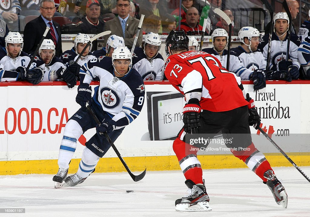 Evander Kane #9 of the Winnipeg Jets stickhandles the puck against Guillaume Latendresse #73 of the Ottawa Senators, during an NHL game at Scotiabank Place, on March 17, 2013 in Ottawa, Ontario, Canada.