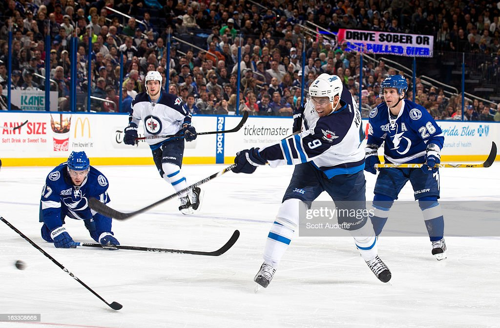 <a gi-track='captionPersonalityLinkClicked' href=/galleries/search?phrase=Evander+Kane&family=editorial&specificpeople=4303789 ng-click='$event.stopPropagation()'>Evander Kane</a> #9 of the Winnipeg Jets takes a shot during the second period of the game against the Tampa Bay Lightning at the Tampa Bay Times Forum on March 7, 2013 in Tampa, Florida.