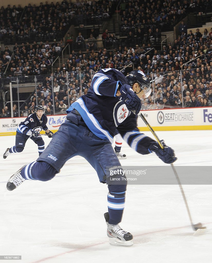 <a gi-track='captionPersonalityLinkClicked' href=/galleries/search?phrase=Evander+Kane&family=editorial&specificpeople=4303789 ng-click='$event.stopPropagation()'>Evander Kane</a> #9 of the Winnipeg Jets takes a shot on goal during first period action against the Washington Capitals at the MTS Centre on March 2, 2013 in Winnipeg, Manitoba, Canada.