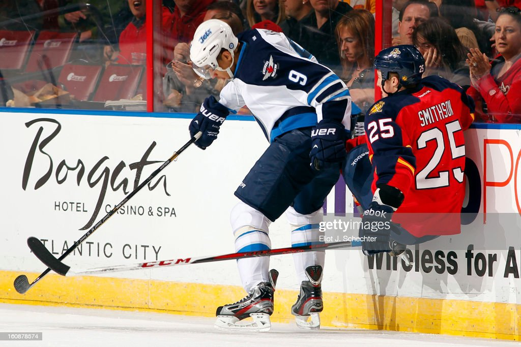 Evander Kane #9 of the Winnipeg Jets tangles with Jerred Smithson #25 of the Florida Panthers at the BB&T Center on January 31, 2013 in Sunrise, Florida.