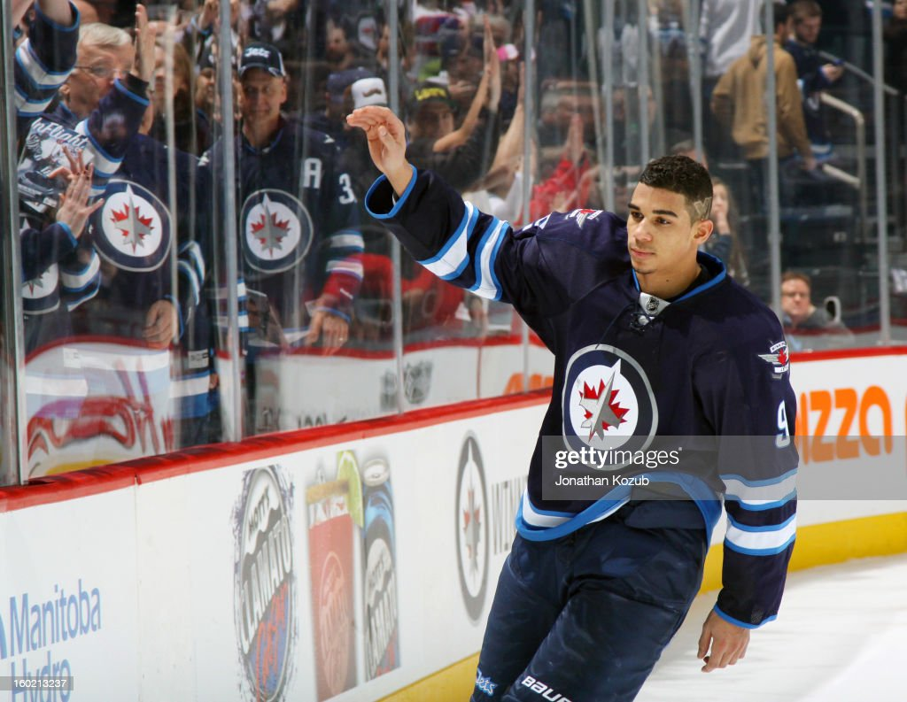 <a gi-track='captionPersonalityLinkClicked' href=/galleries/search?phrase=Evander+Kane&family=editorial&specificpeople=4303789 ng-click='$event.stopPropagation()'>Evander Kane</a> #9 of the Winnipeg Jets waves to the crowd after being named the third star of the game following a 5-4 overtime victory over the New York Islanders at the MTS Centre on January 27, 2013 in Winnipeg, Manitoba, Canada.
