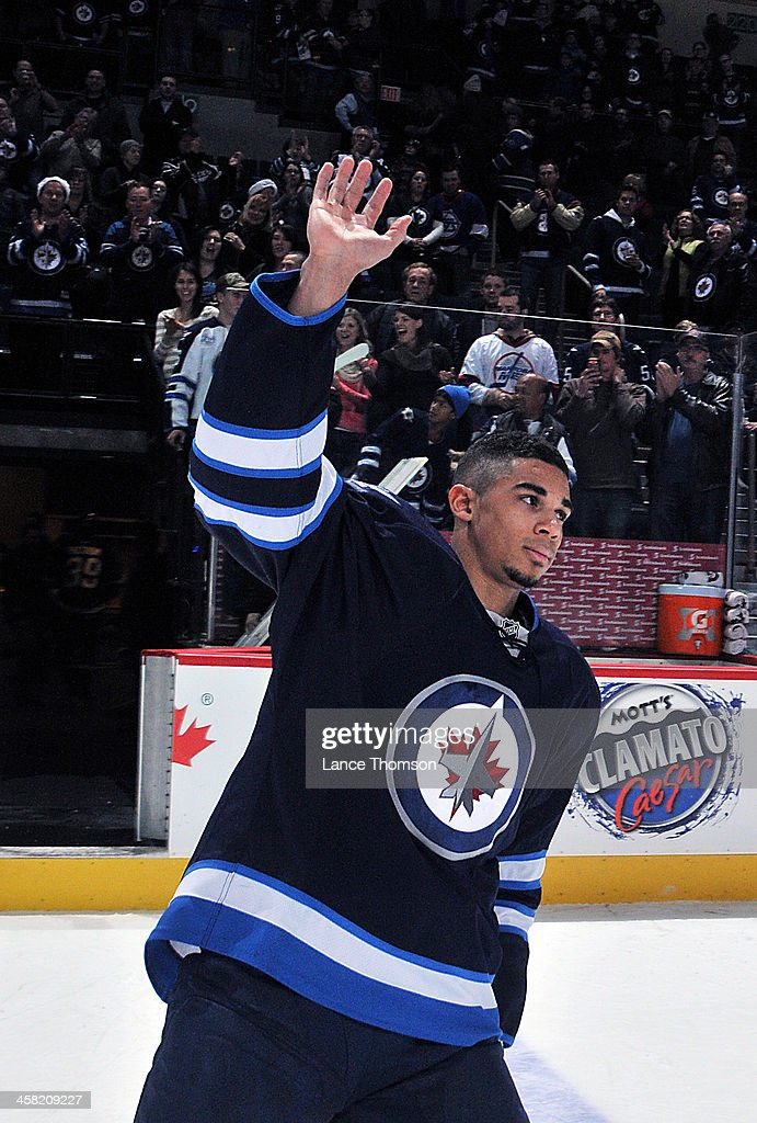 <a gi-track='captionPersonalityLinkClicked' href=/galleries/search?phrase=Evander+Kane&family=editorial&specificpeople=4303789 ng-click='$event.stopPropagation()'>Evander Kane</a> #9 of the Winnipeg Jets waves to the crowd after receiving first star honors following a 5-2 victory over the Florida Panthers at the MTS Centre on December 20, 2013 in Winnipeg, Manitoba, Canada.