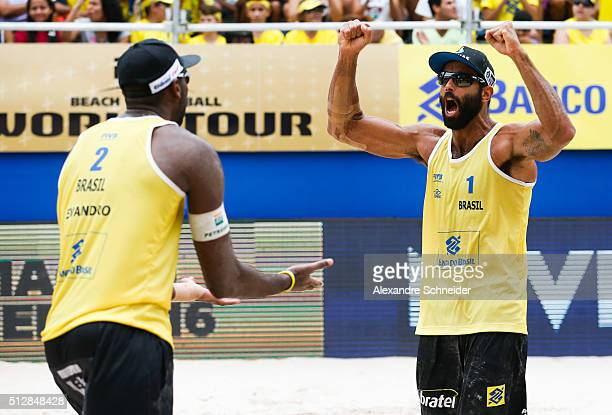 Evandro Goncalves and Pedro Solberg of Brazil celebrate a ponts during the golden medal match agains the United States at Pajucara beach during day...