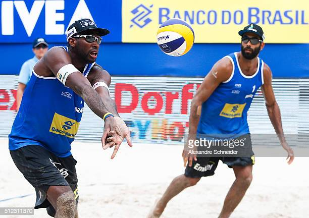 Evandro Goncalves and Pedro Solberg of Brazil compete in the main draw match against the United States at Pajucara beach during day three of the FIVB...