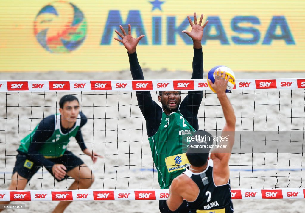 Evandro Goncalves of Brazil blocks the ball during the main draw match against Poland at Parque Olimpico during day two of the FIVB Beach Volleyball World Tour Rio, on May 19, 2017 in Rio de Janeiro, Brazil.