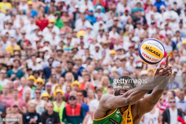 Evandro Goncalves Oliveira Junior of Brazil receives the ball during the gold medal match against Alexander Horst and Clemens Doppler of Austria at...