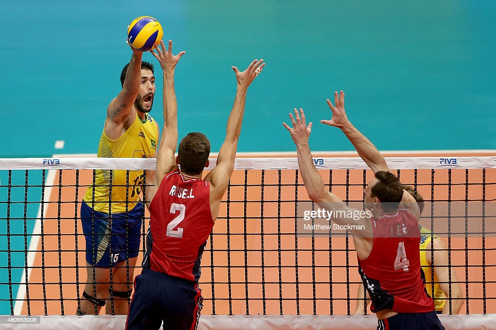 <a gi-track='captionPersonalityLinkClicked' href=/galleries/search?phrase=Evandro+Guerra&family=editorial&specificpeople=11673981 ng-click='$event.stopPropagation()'>Evandro Guerra</a> of Brazil spikes the ball against (L-R) <a gi-track='captionPersonalityLinkClicked' href=/galleries/search?phrase=Aaron+Russell+-+Volleyball+Player&family=editorial&specificpeople=15920615 ng-click='$event.stopPropagation()'>Aaron Russell</a> and David Lee of the United States during the FIVB World League Group 1 Finals match between Brazil and the United States at Maracanazinho Gymnasium on July 16, 2015 in Rio de Janeiro, Brazil.