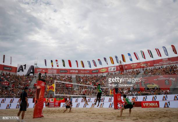 Evandro of Brazil blocked Ben Saxton of Canada during the Men's Quarterfinal match between Canada and Brazil on August 05 2017 in Vienna Austria