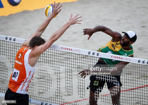 Evandro of Brazil spikes the ball against Christiaan Varenhorst of Netherlands during the Men's Semifinal match between Brazil and Netherland on...