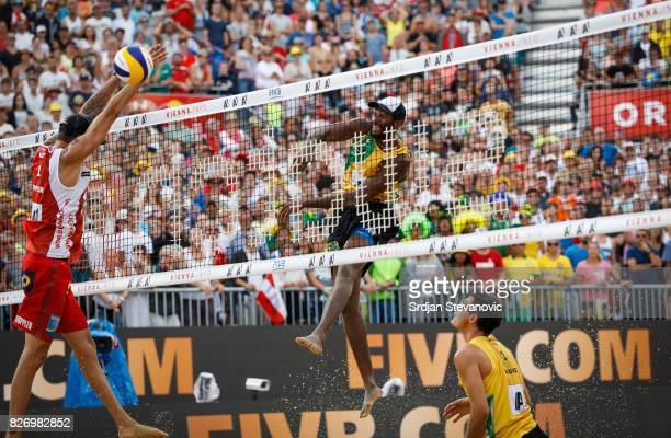 Evandro of Brazil spikes the ball against Clemens Doppler of Austria during the Men's Gold medal match between Brazil and Austria on August 06 2017...