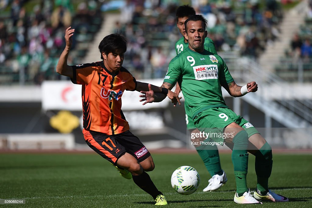 Evandro of FC Gifu and Taiki Kato of Renofa Yamaguchi compete for the ball during the J.League match between FC Gifu and Renofa Yamaguchi at the Nagaragawa Stadium on April 29, 2016 in Nagoya, Japan.