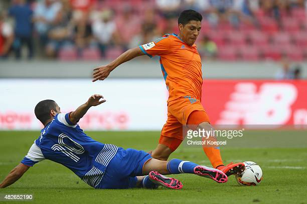 Evandro of Porto fouls Enzo Perez of Valencia during the Colonia Cup 2015 match between FC Valencia and FC Porto at RheinEnergieStadion on August 1...