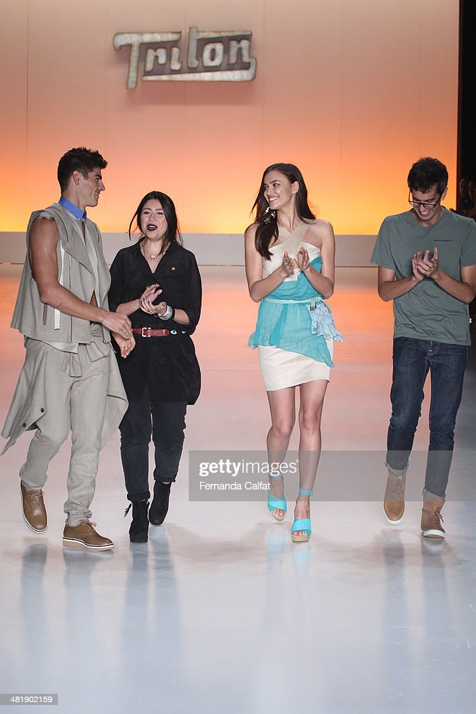 Evandro Soldati Karen Fuke Irina Shayk and Igor de Barros walk the runway at Triton show during Sao Paulo Fashion Week Summer 2014/2015 at Parque...