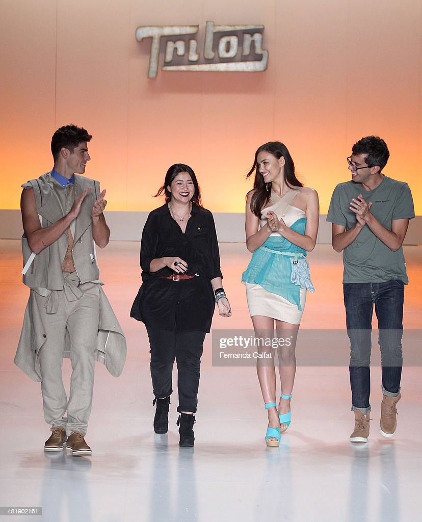 Evandro Soldati, Karen Fuke, Irina Shayk and Igor de Barros walk the runway at Triton show during Sao Paulo Fashion Week Summer 2014/2015 at Parque Candido Portinari on April 1, 2014 in Sao Paulo, Brazil.