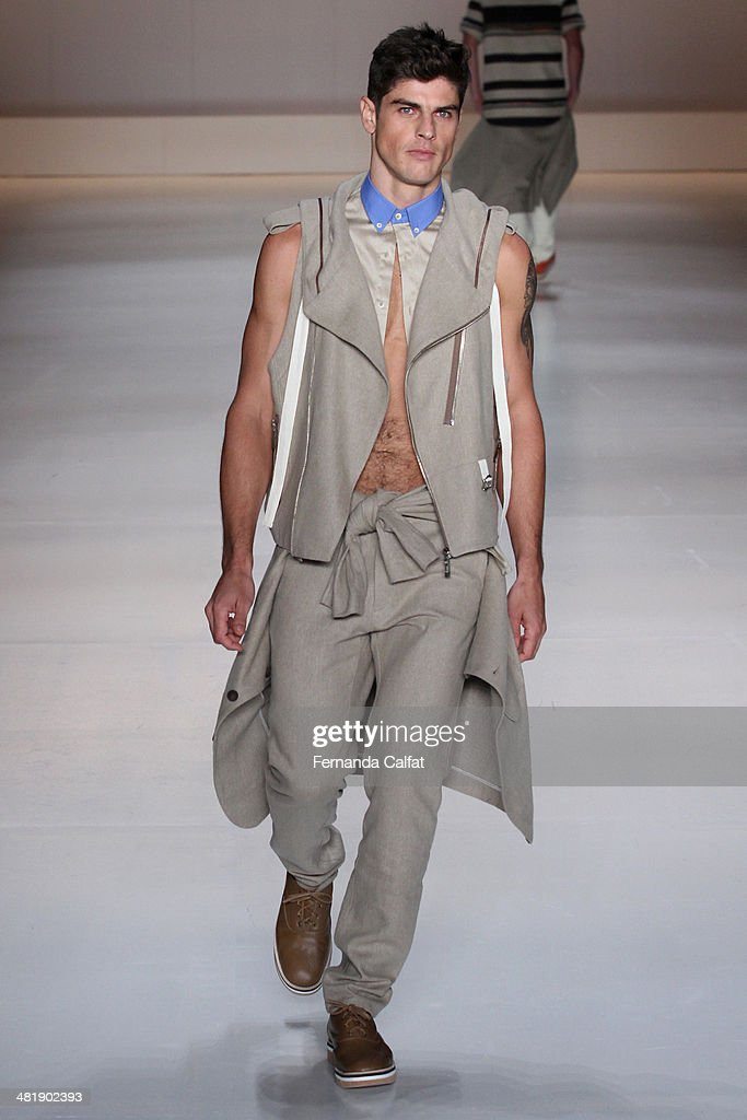 Evandro Soldati walks the runway at Triton show during Sao Paulo Fashion Week Summer 2014/2015 at Parque Candido Portinari on April 1 2014 in Sao...