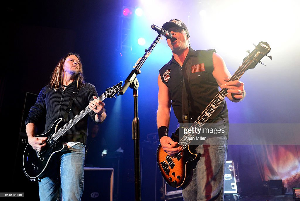 Evanescence guitarist Troy McLawhorn (L) joins Sevendust bassist Vince Hornsby onstage at the Railhead at the Boulder Station Hotel & Casino as Sevendust tours in support of the new album 'Black Out the Sun' on March 23, 2013 in Las Vegas, Nevada.