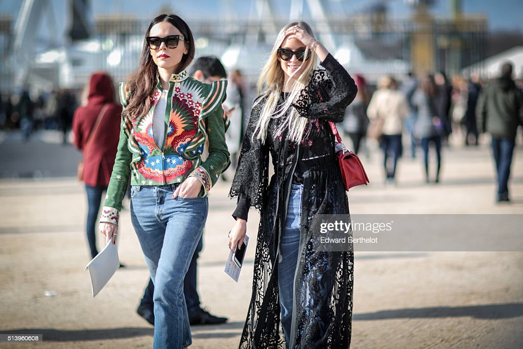 Evangelie Smyrniotaki is wearing a Maison Valentino jacket and Charlotte Groeneveld is wearing a Dior bag before the Elie Saab show during Paris...