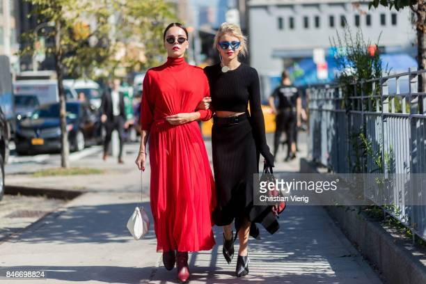 Evangelie Smyrniotaki wearing a red dress and Caroline Daur seen in the streets of Manhattan outside Michael Kors during New York Fashion Week on...