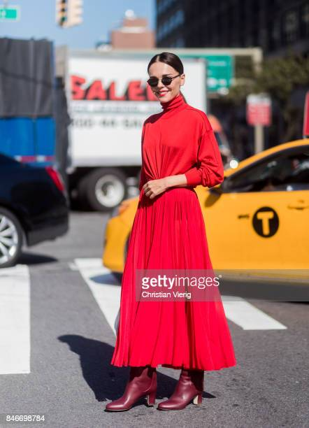 Evangelie Smyrniotaki wearing a red dress seen in the streets of Manhattan outside Michael Kors during New York Fashion Week on September 13 2017 in...