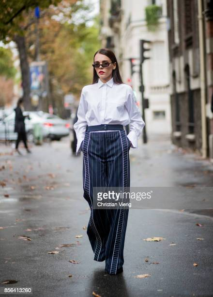 Evangelie Smyrniotaki wearing high waisted pants seen outside Valentino during Paris Fashion Week Spring/Summer 2018 on October 1 2017 in Paris France