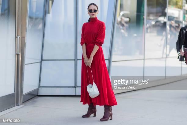 Evangelie Smyrniotaki wearing red dress seen in the streets of Manhattan outside Delpozo during New York Fashion Week on September 13 2017 in New...