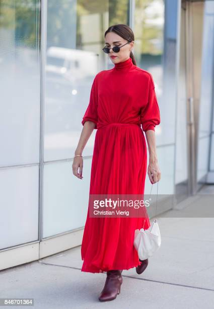 Evangelie Smyrniotaki wearing red dress seen in the streets of Manhattan outside Delpozo during New York Fashion Week on September 13 2017 in New...