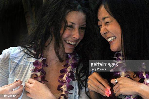 Evangeline Lilly and Yunjin Kim during Cast of 'Lost' Raises Money for American Cross Hurricane Katrina Relief Fund in Honolulu at in Honolulu Hawaii...