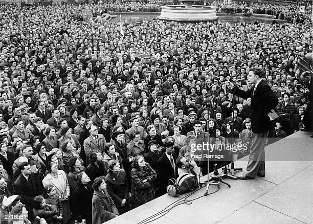 Evangelist Billy Graham addressing the congregation in Trafalgar Square in London
