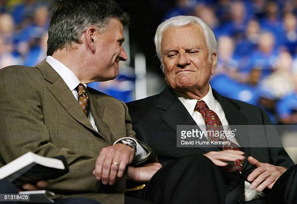 Evangelist Billy Graham and his son Franklin attend a Billy Graham rally on June 12 2003 in Oklahoma City Oklahoma