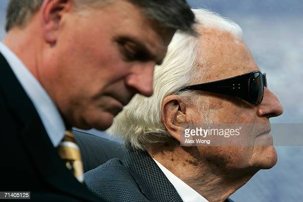 Evangelist Billy Graham and his son Franklin take part in the Metro Maryland 2006 Festival July 9 2006 at Oriole Park at Camden Yards in Baltimore...