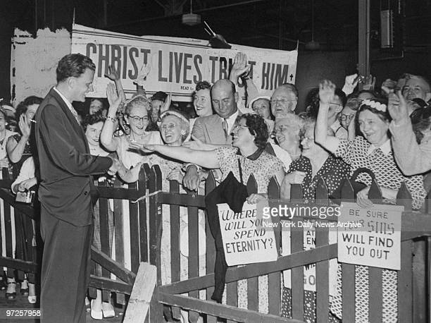 Evangelist Billy Graham greeted by crowd of followers upon arrival aboard the Queen Mary after a fivemonth European tour during which he held record...
