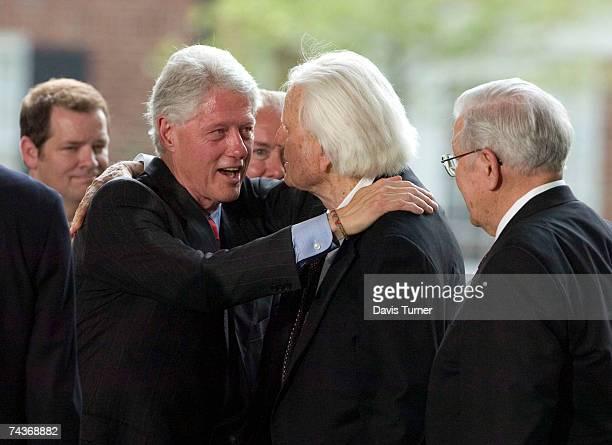 Evangelist Billy Graham is greeted by former US President Bill Clinton on the stage during the Billy Graham Library Dedication Service on May 31 2007...