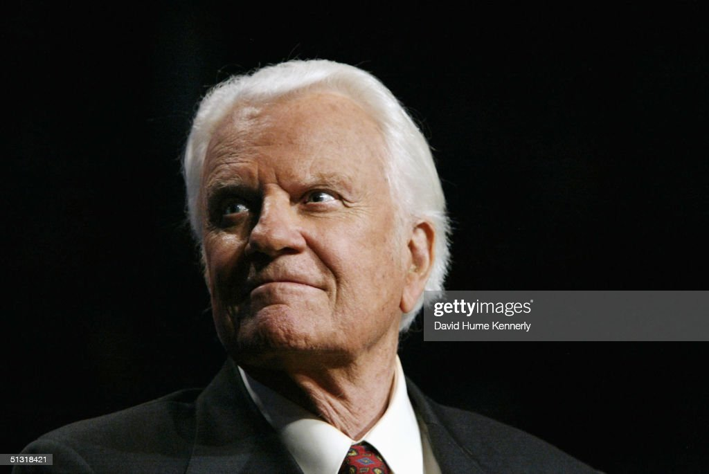 Evangelist <a gi-track='captionPersonalityLinkClicked' href=/galleries/search?phrase=Billy+Graham+-+Evangelist&family=editorial&specificpeople=167098 ng-click='$event.stopPropagation()'>Billy Graham</a> looks on at a <a gi-track='captionPersonalityLinkClicked' href=/galleries/search?phrase=Billy+Graham+-+Evangelist&family=editorial&specificpeople=167098 ng-click='$event.stopPropagation()'>Billy Graham</a> rally on June 12, 2003 in Oklahoma City, Oklahoma.