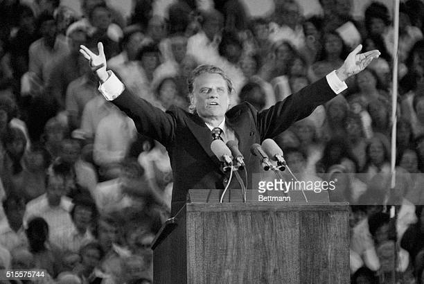 Evangelist Billy Graham preaches to a crowd of 21000 in St Paul Minnesota about Judgement Day