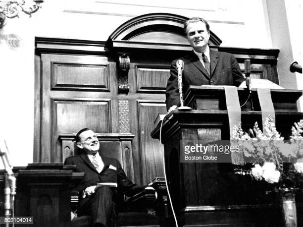 Evangelist Billy Graham right speaks at the Park Street Church in Boston on Feb 16 1964 as the church minister Rev Dr Harold Ockenga looks on at left