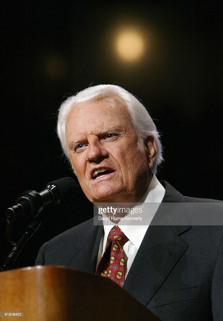 Evangelist <a gi-track='captionPersonalityLinkClicked' href=/galleries/search?phrase=Billy+Graham+-+Evangelist&family=editorial&specificpeople=167098 ng-click='$event.stopPropagation()'>Billy Graham</a> speaks at a <a gi-track='captionPersonalityLinkClicked' href=/galleries/search?phrase=Billy+Graham+-+Evangelist&family=editorial&specificpeople=167098 ng-click='$event.stopPropagation()'>Billy Graham</a> rally on June 12, 2003 in Oklahoma City, Oklahoma.
