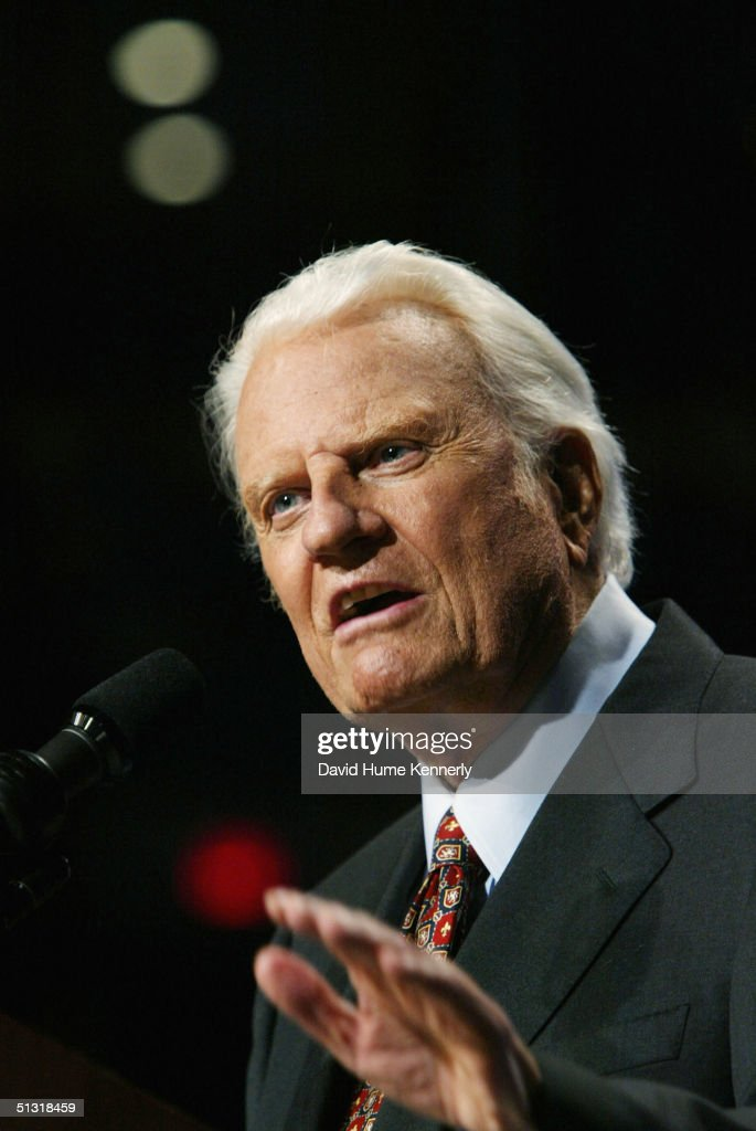 Evangelist <a gi-track='captionPersonalityLinkClicked' href=/galleries/search?phrase=Billy+Graham+-+Evangelist&family=editorial&specificpeople=167098 ng-click='$event.stopPropagation()'>Billy Graham</a> speaks from the podium at a <a gi-track='captionPersonalityLinkClicked' href=/galleries/search?phrase=Billy+Graham+-+Evangelist&family=editorial&specificpeople=167098 ng-click='$event.stopPropagation()'>Billy Graham</a> rally on June 13, 2003 in Oklahoma City, Oklahoma.