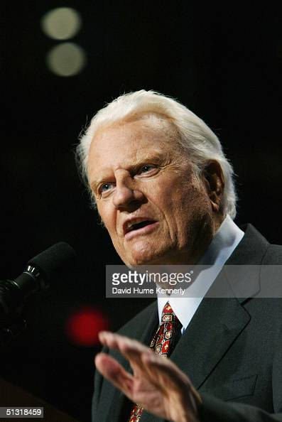 Evangelist Billy Graham speaks from the podium at a Billy Graham rally on June 13 2003 in Oklahoma City Oklahoma