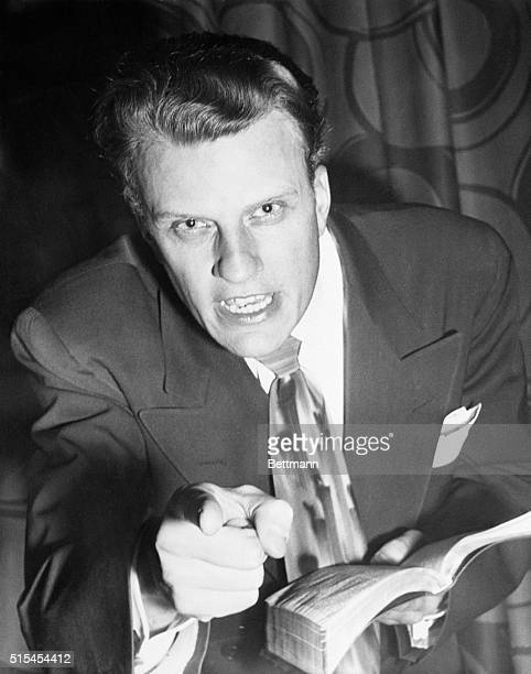 Evangelists Billy Graham as he spoke at the Hotel Statler under the sponsorship of the Committee of Ministers of Greater New York warning people that...