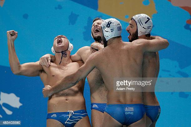 Evangelos Delakas and Christos Afroudakis of Greece celebrate with their team after defeating the Italy team in their Men's bronze medal match with a...
