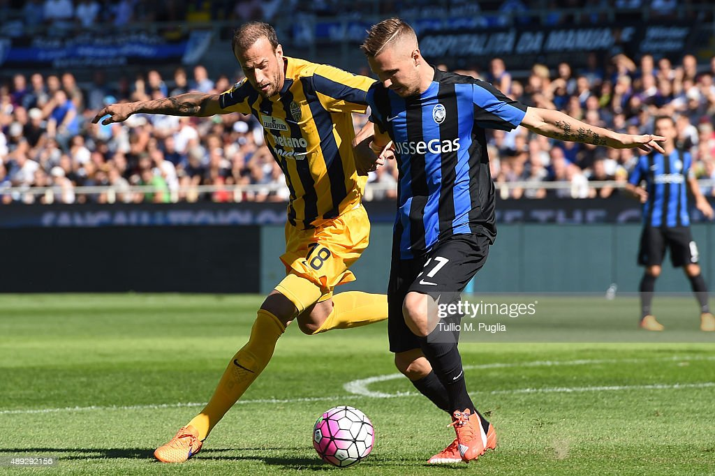 Evangelos Moras (L) of Hellas Verona and <a gi-track='captionPersonalityLinkClicked' href=/galleries/search?phrase=Jasmin+Kurtic&family=editorial&specificpeople=7418994 ng-click='$event.stopPropagation()'>Jasmin Kurtic</a> of Atalanta compete for the ball during the Serie A match between Atalanta BC and Hellas Verona FC at Stadio Atleti Azzurri d'Italia on September 20, 2015 in Bergamo, Italy.