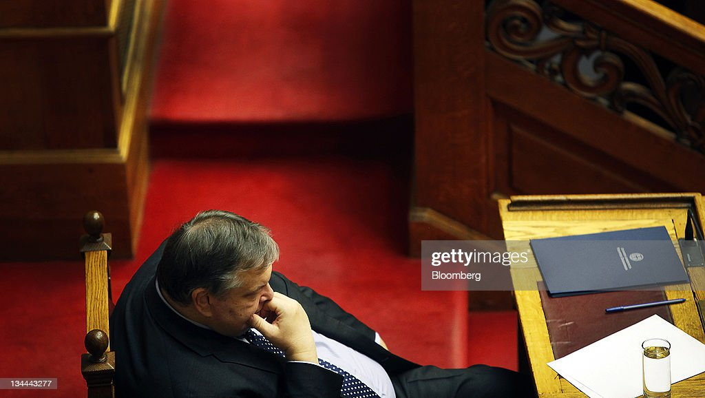 <a gi-track='captionPersonalityLinkClicked' href=/galleries/search?phrase=Evangelos+Venizelos&family=editorial&specificpeople=2820810 ng-click='$event.stopPropagation()'>Evangelos Venizelos</a>, Greece's finance minister, listens during a confidence vote at the Greek parliament in Athens, Greece, on Friday, Nov. 4, 2011. Papandreou said he'll move toward a cross-party administration as early general elections should not happen now as they would put in doubt the Oct. 26 agreement with the European Union. Photographer: Angelos Tzortzinis/Bloomberg via Getty Images
