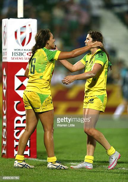 Evania Pelite of Australia is congratulated by team mate Alicia Quirk after scoring a try against Russia during the Emirates Dubai Rugby Sevens HSBC...