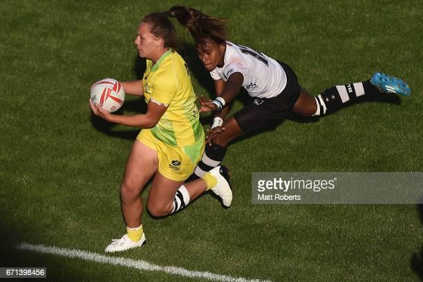 Evania Pelite of Australia makes a break during the HSBC World Rugby Women's Sevens Series 2016/17 Kitakyushu pool match between Australia and Fiji...