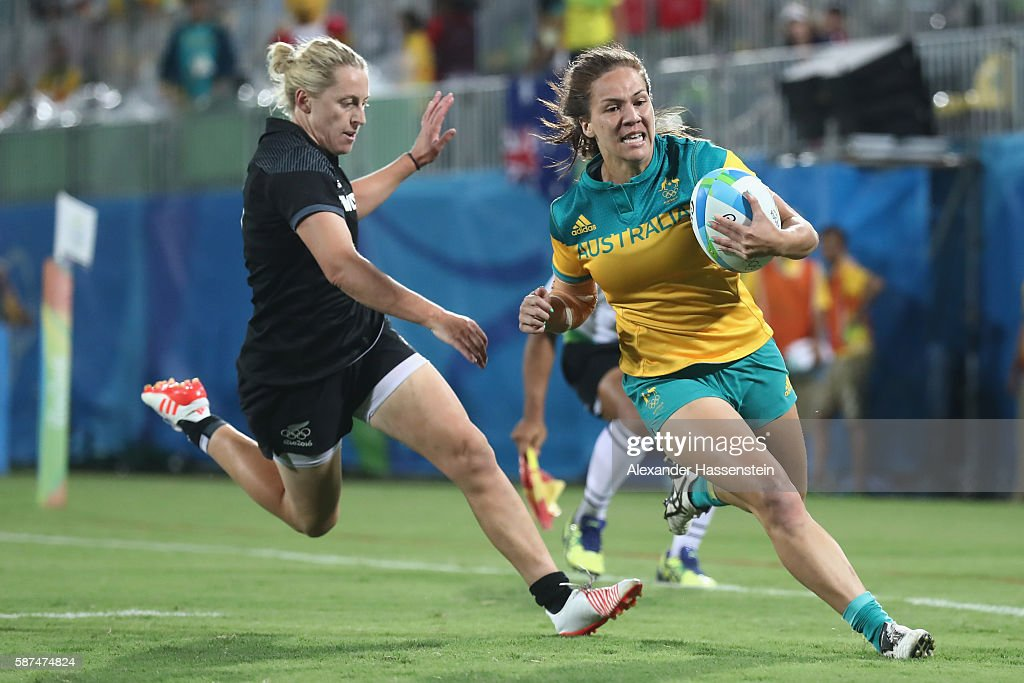 Evania Pelite of Australia scores a try against Kelly Brazier of New Zealand during the Women's Gold Medal Rugby Sevens match between Australia and...