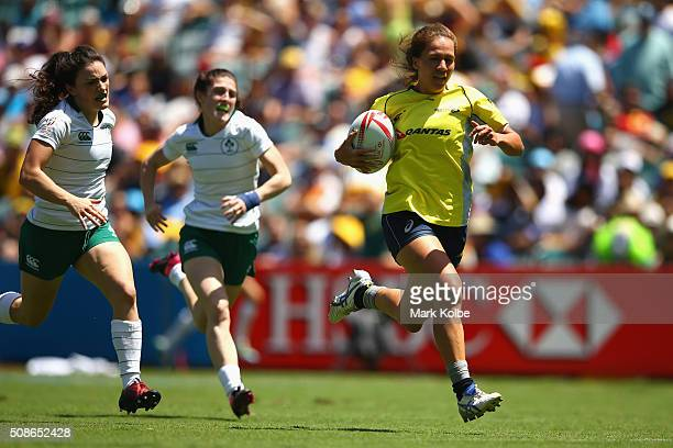 Evania Peliteof Australia makes a break on her way to score a try during the 2016 Sydney Sevens women's exhibition match between Australia and...