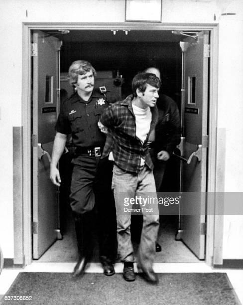 S DEPUTY BILL BUTLER ESCORTS TONY EVANS INTO HOSPITAL Evans' companion Leonard Hardin is accused of shooting a Nederland officer Credit The Denver...