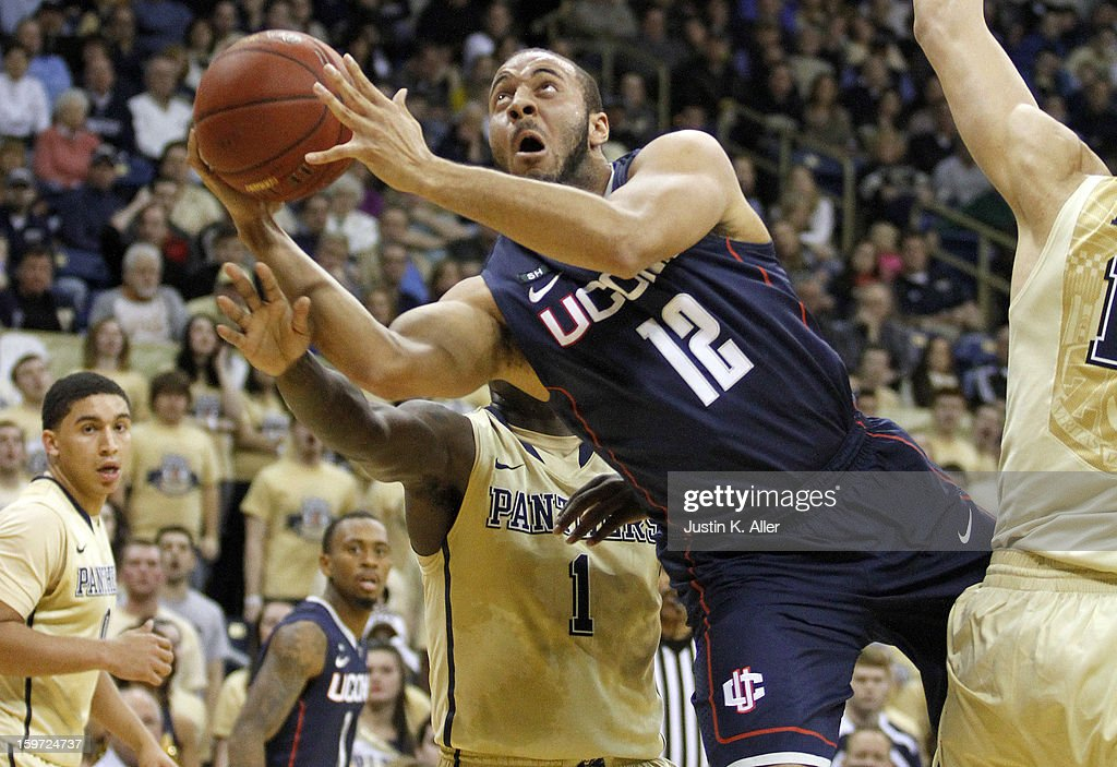 R.J. Evans #12 of the Connecticut Huskies falls while attempting the shot against the Pittsburgh Panthers at Petersen Events Center on January 19, 2013 in Pittsburgh, Pennsylvania. PITT defeated UCONN