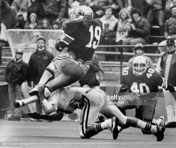 Evasive Hurdling Fails After Big Gainer Tony Reed of Colorado tries to hurdle unidentified Kansas tackler after picking up 12 yards on draw play to...